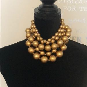 Gold pearl necklace and earrings
